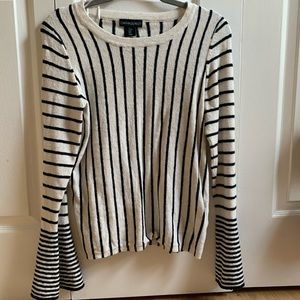 Striped sweater with trumpet sleeve